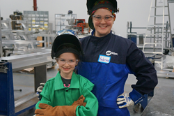 Women introducing Girl Scouts to Welding