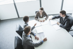 Four people at a table having a meeting